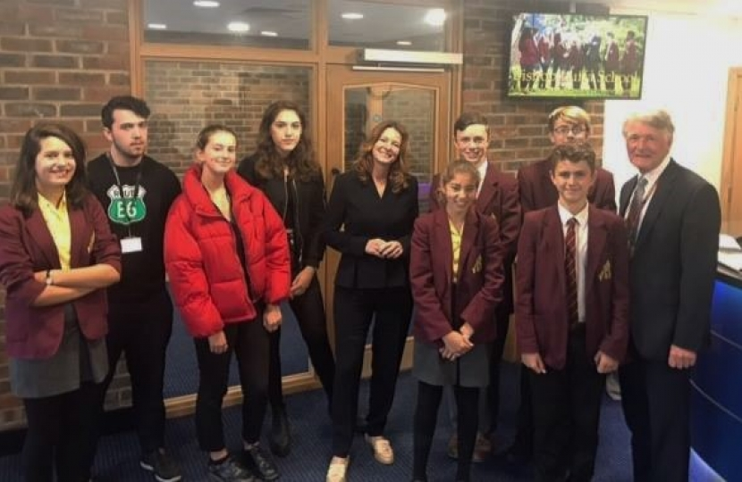 Gillian with students and Head Teacher of Bishop Luffa School