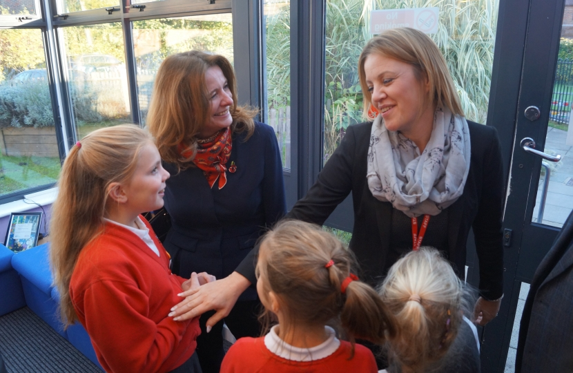 Gillian with Deputy Head at Bosham and children who showed her around